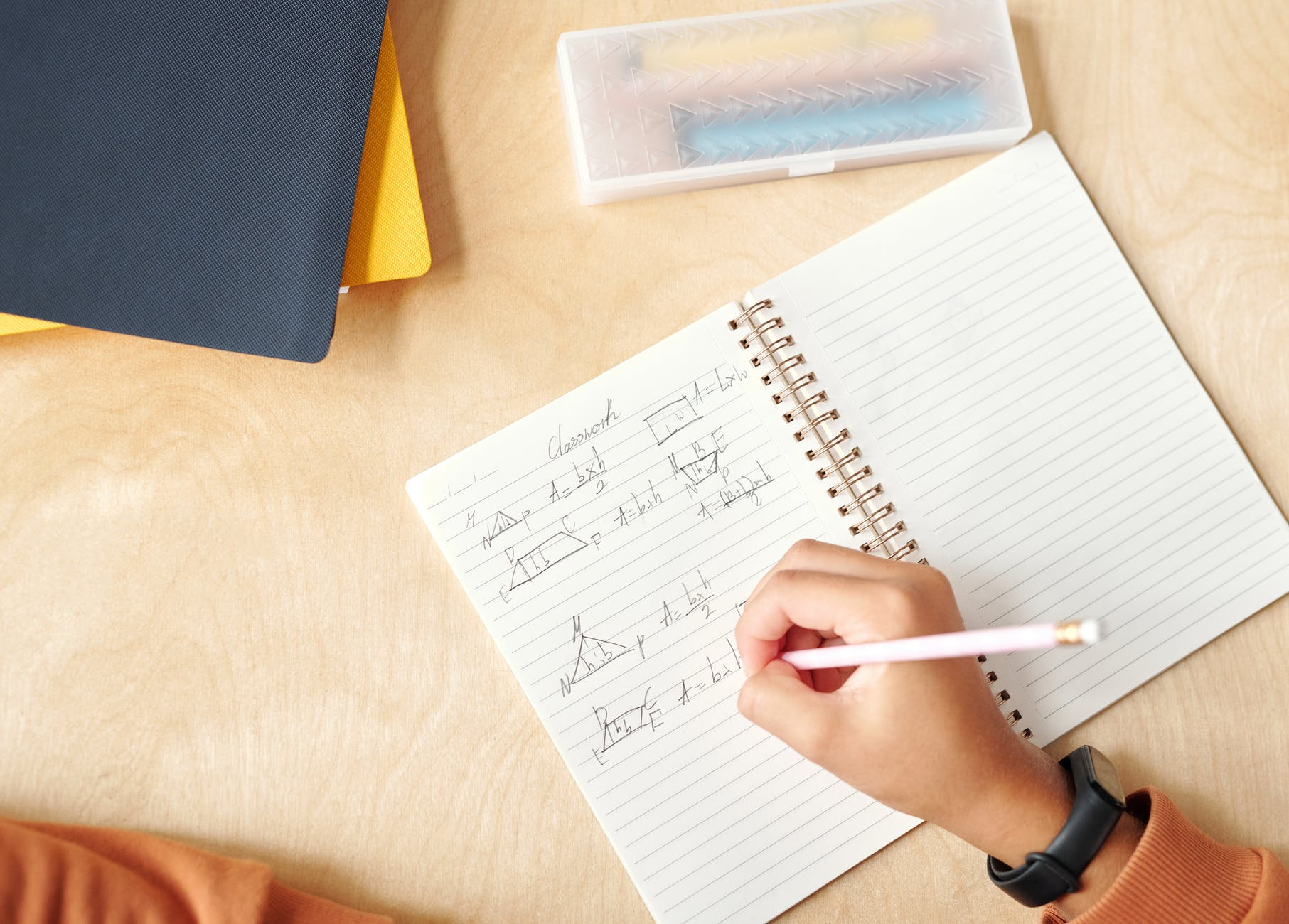 white notebook with pen on table